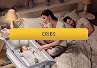 baby in cosleeping crib attached to parents bed