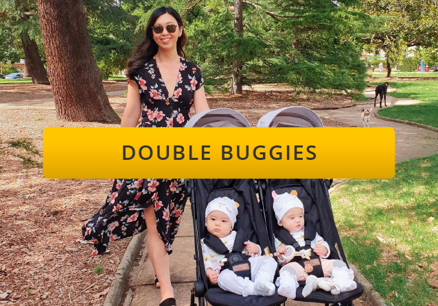 mother pushing twins in a double buggy