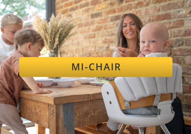 baby sitting in icandy highchair