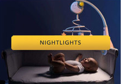 baby in a crib with a nightlight