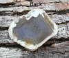 Image shows the back side of the Agate pendant. Agates may be many colors: blue, brown, red, or yellow. Agates usually have banded formations or lines running through the various colors of the stone. You can sort of see through them. Agates hold great energetic properties: they encourage calmness and consciousness of life's experiences. promote inner growth and sensibility, and can balance the physical body and all the aura layers.  Stone is chosen, spiritually cleansed and package with an abundance of gratitude and high vibe positive energy.