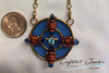 Round Powerhouse of  healing energy magnified with copper and crystals on a 22 inch chain. seen compared to a quarter. double claw clasp for support.