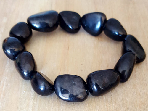 Shungite Bracelet The Black Beauty EMF Protector This is an extremely light weight stone that has the appearance of coal or metal. It looks similar to Hematite, but it has a purifying energy and cleans your space. This means it is an EMF protector. It protects your aura and protects you from harmful frequencies emitted by cell phones, the electric waves from your power company, computers and harmful electronics that have smart meters within them. It is used in hospitals in Russia to accelerate healing for patients and for absorbing toxins such as radiation. Believe it or not this Shungite is ground up and used for facial creams to keep you youthful! It has fullerenes that are healing and regenerative for humans. Everyone should has a piece of this for their cell phone or office. Learn more about Shungite by reading: Copyright © DeMarco,J. (2019) High Vibes Crystal Healing. Florida: Llewellyn Publishing Ultimate protection of Negative EMF's and all that is of low vibration! Attach a Shungite to your cell phone or computer, you are receiving too many vibes that can cause you harm.  Keep your self away from negative situations that arise, be neutral and stay out of any conflicts!    Crystal is chosen, spiritually cleansed and packaged with an abundance of gratitude and high vibe positive energy.