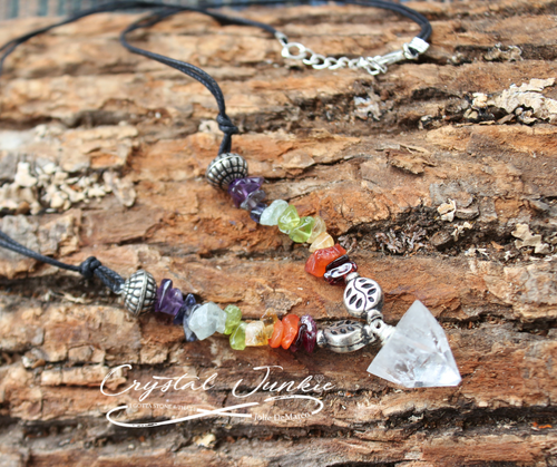 This Chakra Apophyllite Crystal Necklace with 8 different crystals with a pointed crystal Apophyllite. Apophyllites are actually naturally formed crystal pyramids. Apophyllite is a very bright, light crystal that promotes reflection; it is great for grids, energy work, and meditation. Apophyllites magnify and focus energy through the apex of the pyramid shape and can enhance intuition. It's a wonderful crystal for the third eye and crown chakra by virtue if its bright clarity formed naturally into a pyramid shape, exemplifying the high spiritual vibration of sacred geometry. It can connect one to the higher planes, bringing new wisdom through the subconscious. Apophyllites are in the quartz family which makes them amplifiers of goodness. Apophyllites crystals can help one increase intuition, connect with guides, and practice remote viewing.  Beautiful crystal chips for each chakra which keeps yourself cleared, protected, empowered, balanced, encouraged, and improved love and compassion. This crystal Apophyllite necklace is unique with mother earth's own design. The crystals lay perfectly around a rope necklace with a lobster claw clasp.  This necklace is chosen, spiritually cleansed and packaged with an abundance of gratitude and high vibe positive energy.