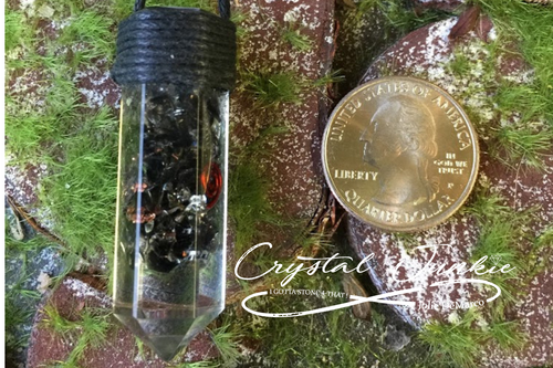 Orgonite - Orgonite - Quartz and other Crystals in Resin with Copper and metals seen here as sized next to a quarter
