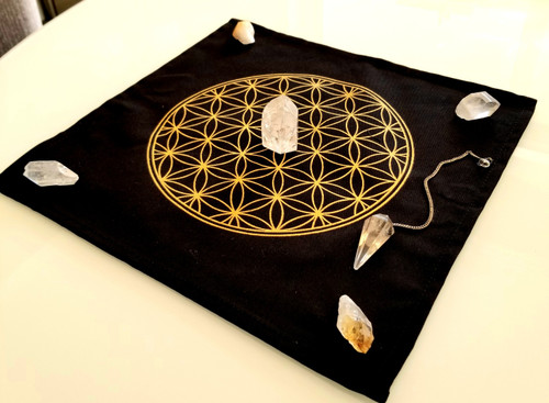 Sacred geometry set- (1) Flower of life Crystal grid mat, (2) Citrine crystals, (2) quartz crystals , (1) Quartz Generator point and (1) Crystal Rockin' Pendulum!