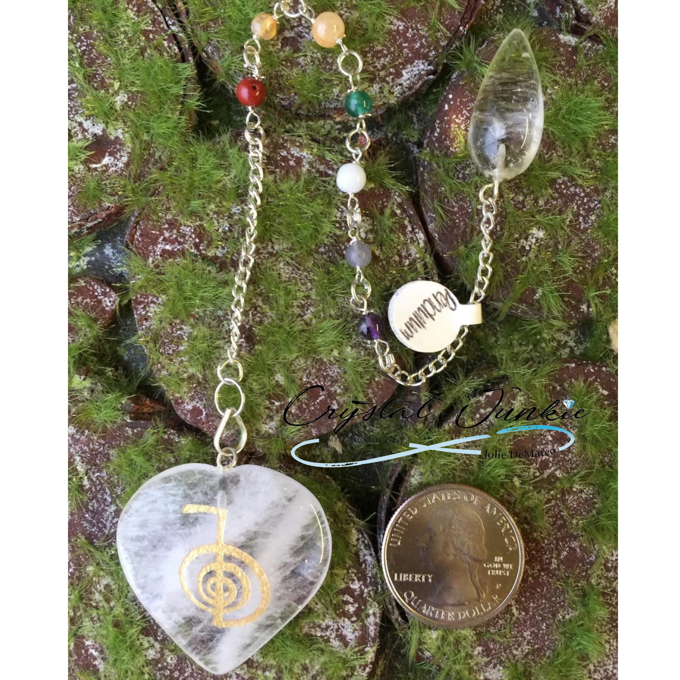 heart-quartz-pendulim-with-quarter.png