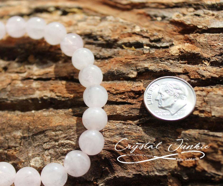 light-pink-quartz-bracelet-with-dime.png