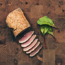 Smoked duck sliced on chopping board
