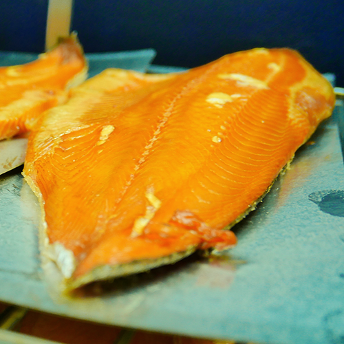 Side of hot smoked salmon straight out of the kiln