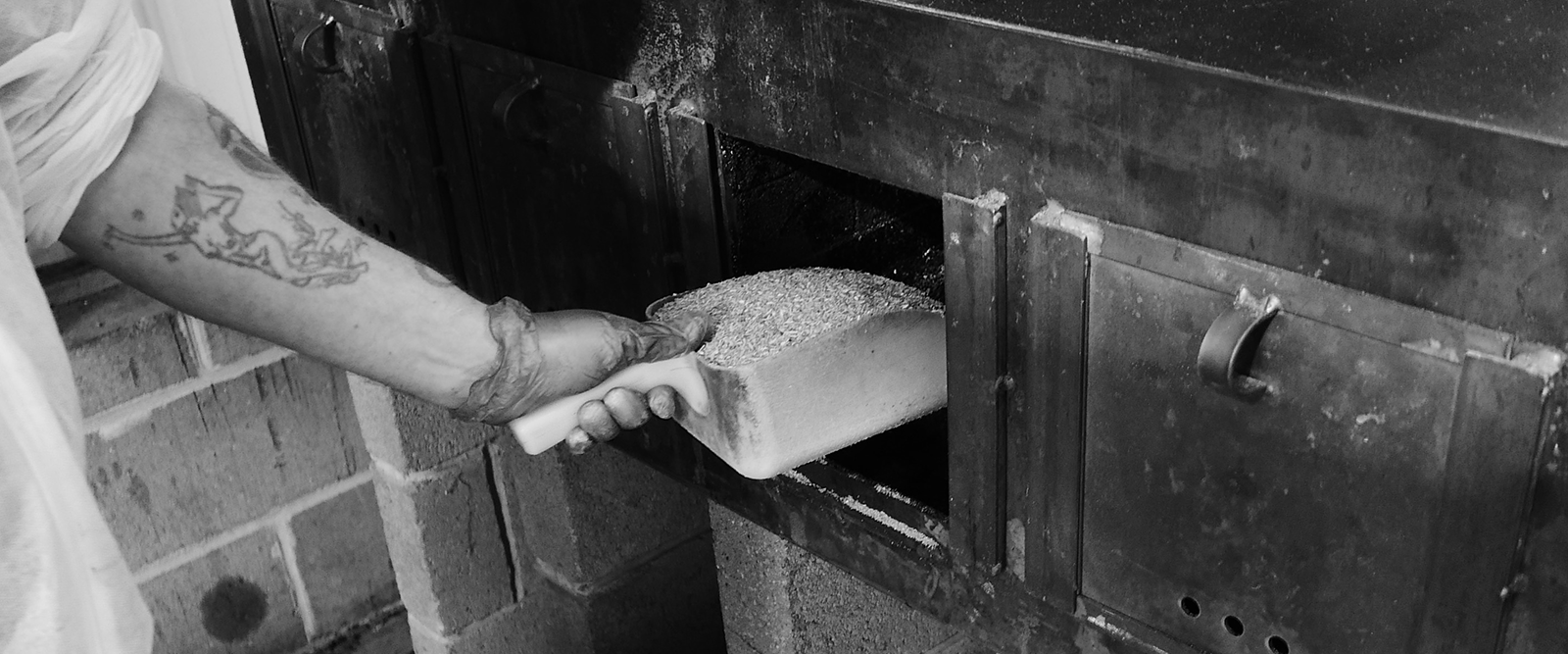 Adding wood chips to the kiln