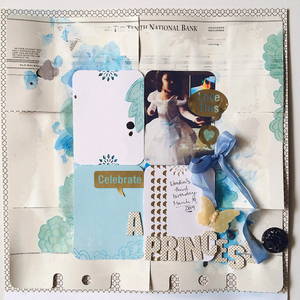 Hybrid layout by Nirupama Kumar.  Niru printing some of the blue patterned paper from our Sunny Skies kit onto vellum and colored with gelatos.
