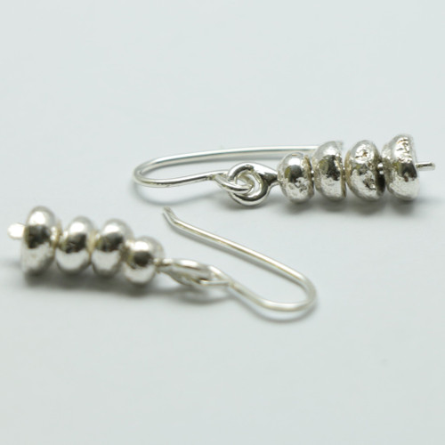 Silver Periperi earrings, Justin Ferguson.