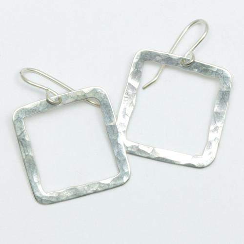 Square pirori earrings, sterling silver, Justin Ferguson.