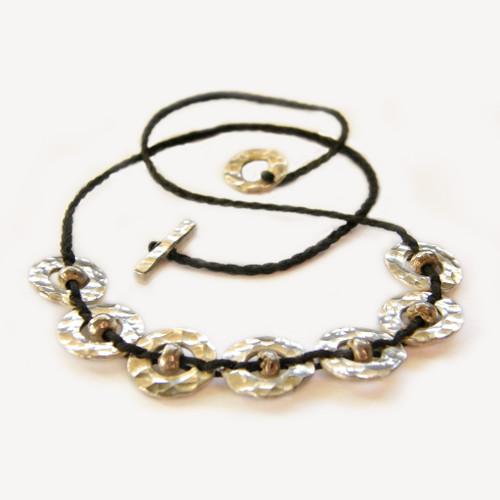 Silver 7 piece Amionga necklace, Justin Ferguson.