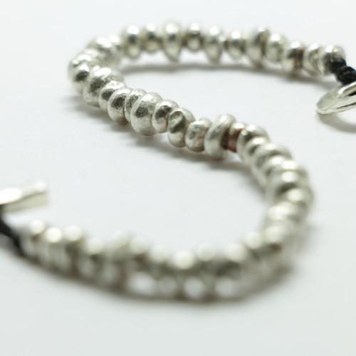 Silver and brass Pirepire necklace, Justin Ferguson,