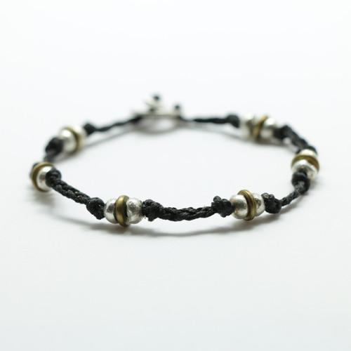 Braided silver and brass Periperi bracelet, Justin Ferguson.