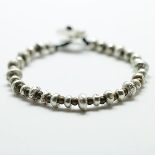 Silver and brass Periperi bracelet, Justin Ferguson.