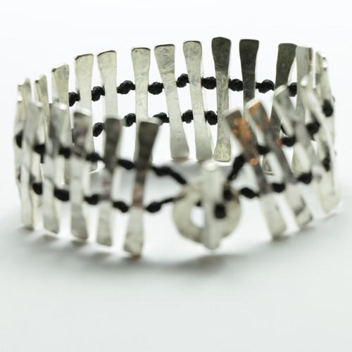 Silver Tuwatawata bracelet, Justin Ferguson.