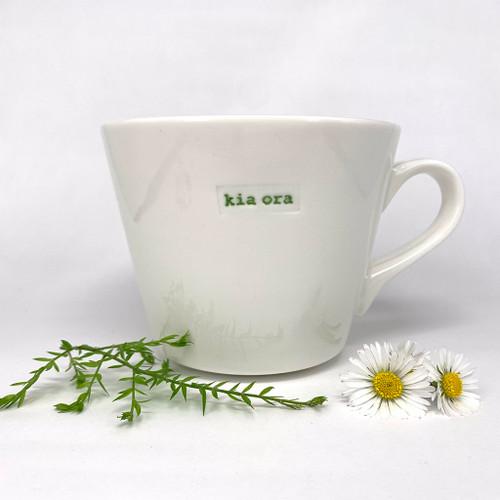 cream ceramic mug, 350ml capacity, kia ora stamp,