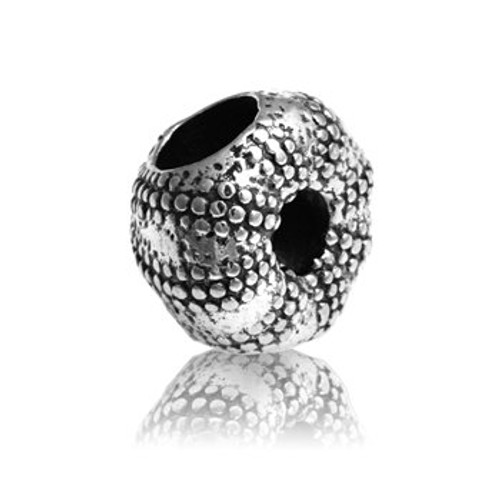Sterling silver kina charm from Evolve New Zealand.