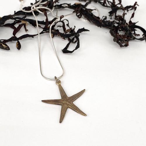 Bronze starfish pendant on sterling silver snake chain, Bob Wyber NZ.