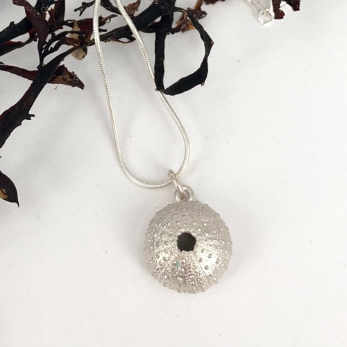 Sterling silver kina pendant from Bob Wyber.