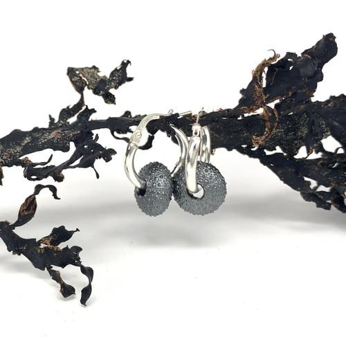 Darkened sterling silver kina hoop earrings, Bob Wyber.