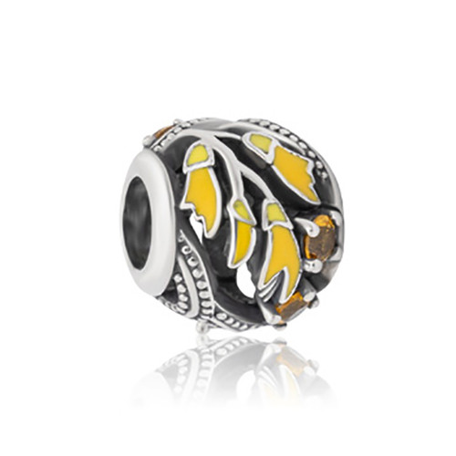 Kowhai sterling silver, enamel and cubic zirconia charm from Evolve New Zealand.