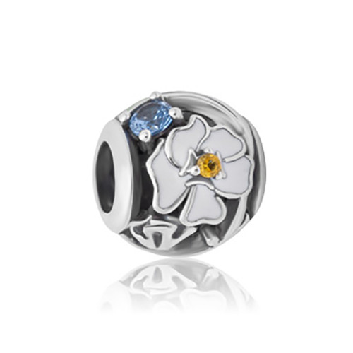 Mt Cook Lily  sterling silver, enamel and cubic zirconia charm from Evolve New Zealand.
