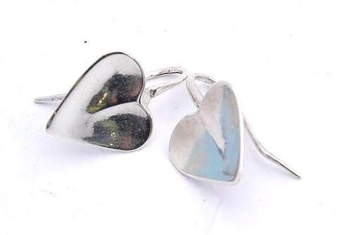 Silver heart earring by NZ jewellery designer Nick Feint, Stone Arrow