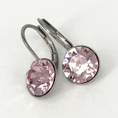 Light amethyst coloured swarovski crystal loop earring, silver plate over tombac,  Isa Dambeck.
