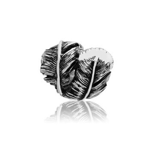 Sterling silver huia charm from Evolve New Zealand.