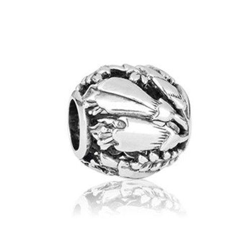 Sterling silver kowhai charm from Evolve New Zealand.