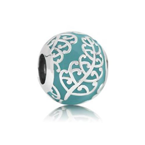 Koru fern sterling silver and enamel charm from Evolve New Zealand.