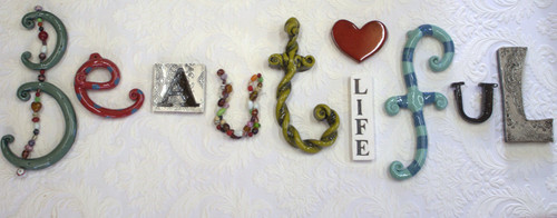 Beautiful life ceramic wall art by the Monster Company.