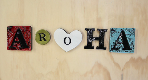 Ceramic aroha word wall hanging  from The Monster Company. Made in NZ.