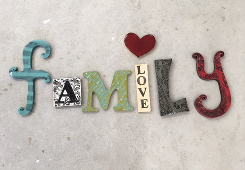 Ceramic family word wall hanging  from The Monster Company. Made in NZ.