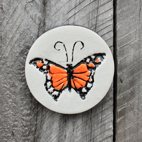 Ceramic Monarch butterfly ceramic disc from The Monster Company. Made in NZ.