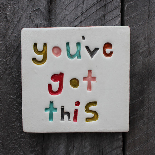 You've got this stamped ceramic tile from The Monster Company. Made in NZ.