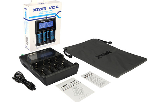 This image shows the contents of the box, charge unit, USB cable, instructions and storage pouch. The box itself may vary.
