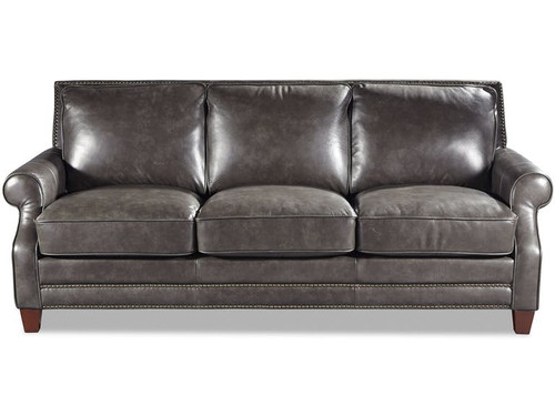 Traditional Style Leather Sofa featuring double rows of nails around the top rail as well as across the front tail.