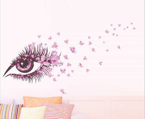 This design is made of quality vinyl and will add a great focal point to any room of your home.   It features a large eye and pink butterflies, and the example shown measures 135x65cm.  The completed size will depend on your placement.  It is a peel & stick type