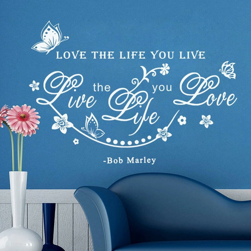 Love the Life you Live, Live the Life you Love - Bob Marley Removable wall decal.  It is made of quality vinyl and will look fabulous any room of your home.     The example shown measures 65x45cm, but the completed size will depend on your placement  A clear plastic sheet of film (also known as the transfer sheet) is provided with the decal in order to transfer the design from the backing paper to the wall.  It can also be used to store and re-apply your design should you ever have the need to move it.  The letters in this design are placed on the backing paper individually.