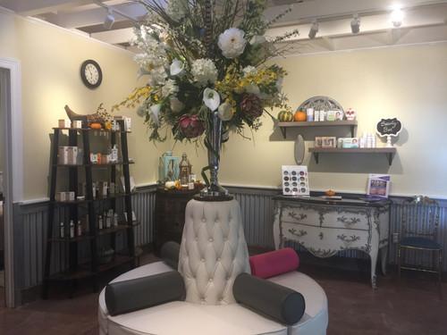 Spa sitting salon sofa with flower vase