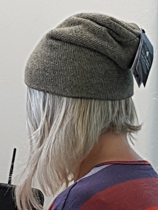 Julie modelling our NZ Natural Clothing Woollen Beanie while putting it up online!