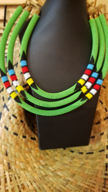"Kenyan African Jewelery # 2  Handmade item Materials: Tube, Maasai Fine Beads Closure: Hook Chain style: Bead Adjustable length  Zulu Statement Necklace, Beaded Africa Necklace, Maasai Necklace, Afrocentric Necklace, Maasai Beadwork Necklace, Kenyan Jewelry DIMENSIONS  Inner strand : 16"" inches Middle strand : 18"" inches Outer strand : 20"" inches"