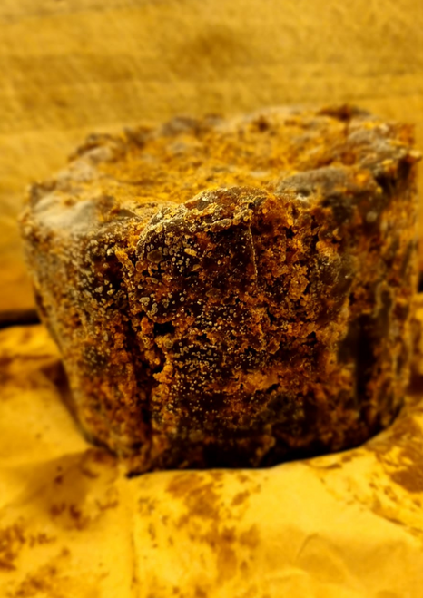 Paulie African Black Soap per 450g From Ghana   The soap is a natural source of vitamins A and E; this makes it a good skin cleanser by supporting collagen production and helping to keep skin firm and smooth and also aiding in acne treatments . Similarly, the soap also supports the tissue structure and helps to moisturize and improve skin texture and tone .   Recent studies suggest that the antioxidants from the vitamins contained in African Black Soap help to prevent free radical damage which can lead to visible signs of aging; demonstrating potentials for remedy of dandruff and itchy scalp, evening out dark spots, eczema, razor bumps and eliminating blemishes . Black soap contains a high amount of glycerin, which absorbs moisture from the air and literally deposits it into the skin, making the skin soft and supple   African black soap halts from west African and is much sought after on account of its efficacious effect on the skin. The local black soap also helps to get rid of acne and fade scars.