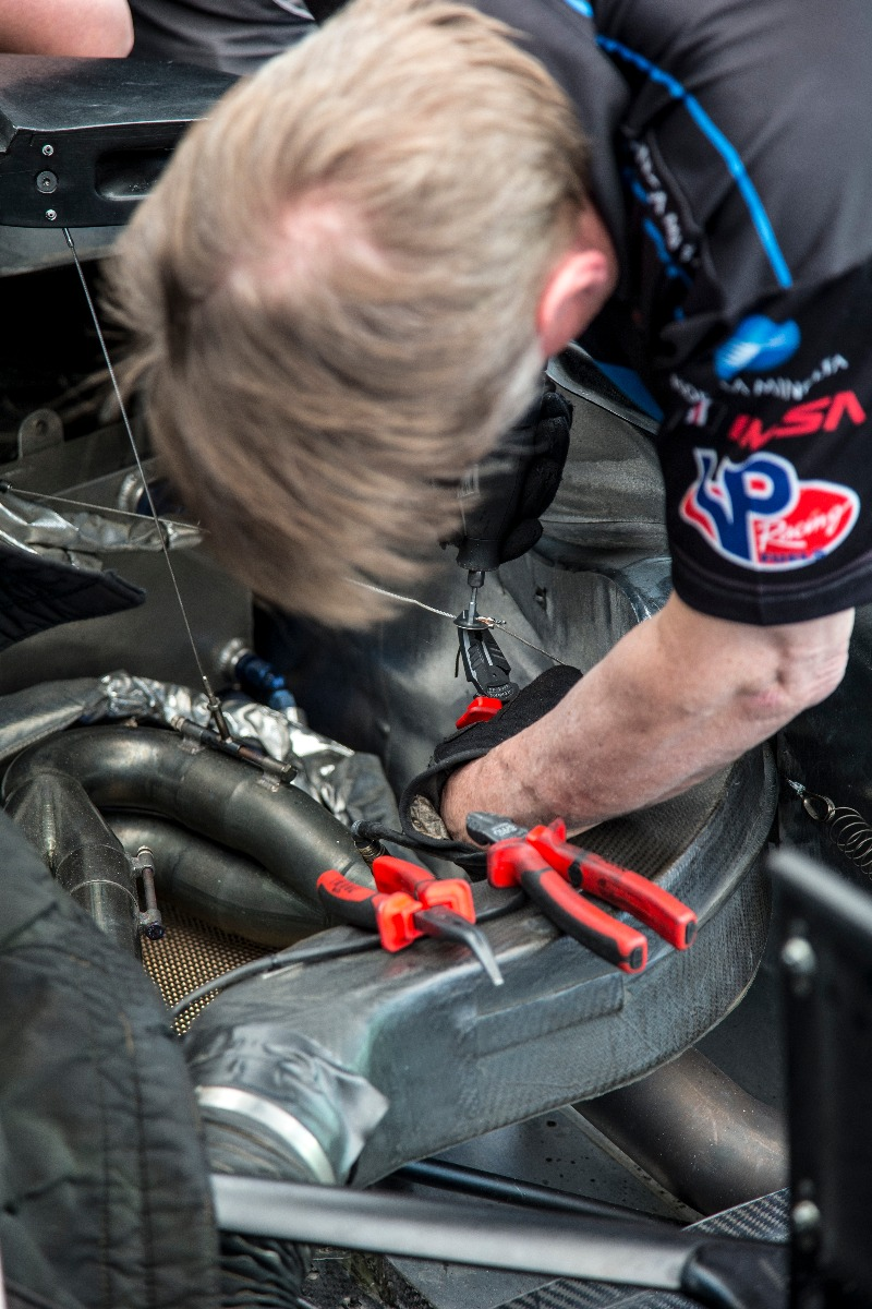 Technician using Sonic combination pliers to repair an engine