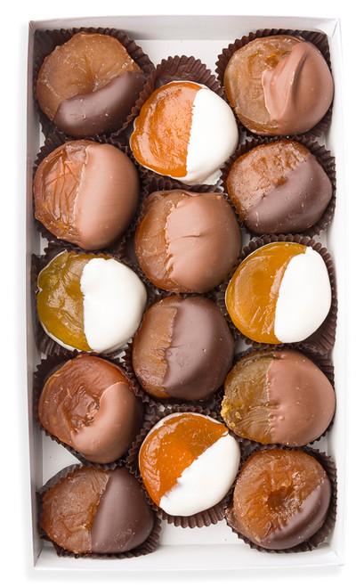 Glazed apricots in milk chocolate, dark chocolate, and white chocolate